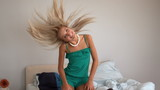 Attractive blonde shaking her hair