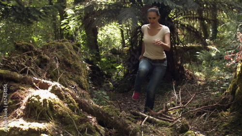 Casual young woman running in the woods