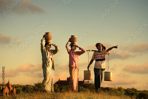 traditional asian farmer during sunset at a rice field in bagan,