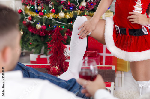 sexy female Santa seduces man on Christmas Eve