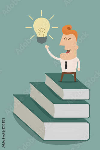 businessman standing on a stack of books to light bulb