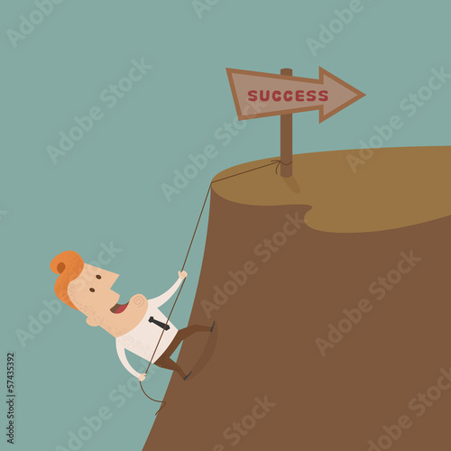Businessman climbing on the rocks