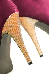 Close up of High Heels shoes in red and shiny gold
