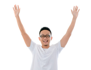 casual asian man with hands raised eyes closed