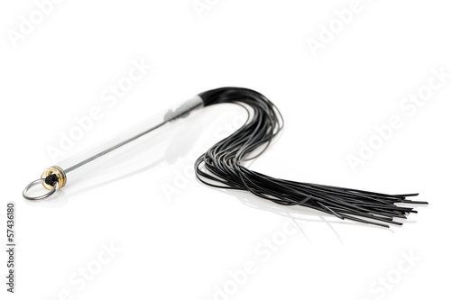 A whip for fetish games isolated on white.