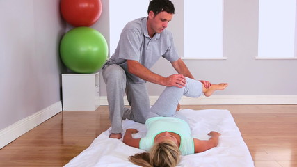 Physiotherapist working and talking with a patient