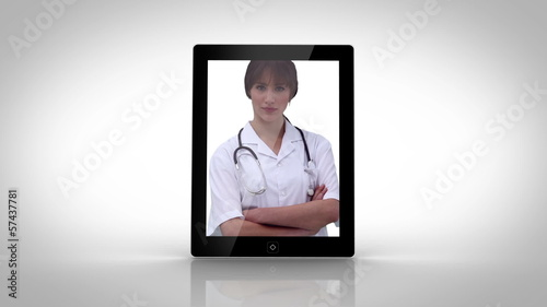 Tablet showing doctors at work
