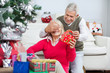 Happy Man Covering Woman's Eyes While Giving Christmas Gift