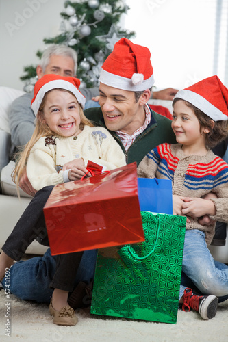 Siblings And Father With Christmas Presents