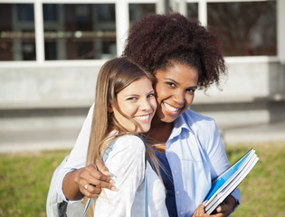 Woman Standing With Arm Around Friend On Campus