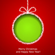 Abstract Xmas greeting card with green Christmas ball cutted fro