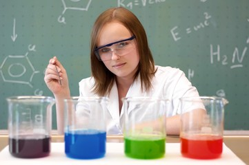 Woman analyzing chemical material
