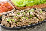 Bulgogi - Korean grilled beef with side dishes and lettuce
