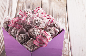 Sweet chocolate balls on wood