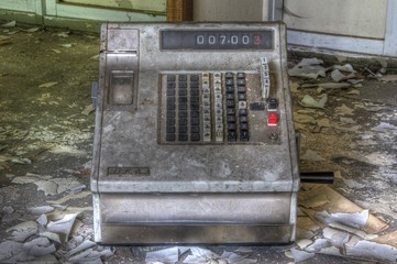 Old cash machine in an abandoned market
