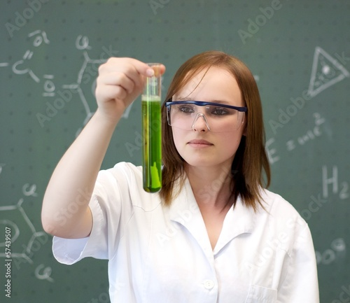 Female student experimenting in a lab