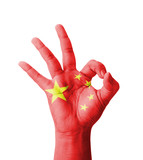 Hand making Ok sign, China flag painted