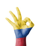 Hand making Ok sign, Colombia flag painted