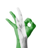 Hand making Ok sign, Nigeria flag painted