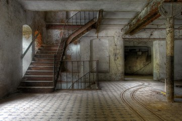 Old stairs in an abandoned hall