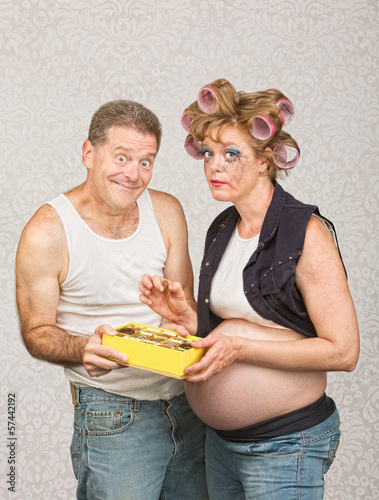 Smiling Man Feeding Pregnant Woman