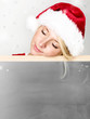 Women with santa hat sleeping on message board