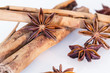 Star anise and cinnamon on a white background