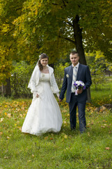bridal couple walks in autumn