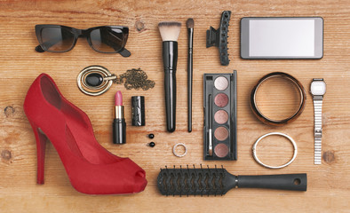 Overhead of essentials fashion woman objects.