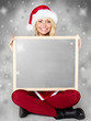 Women with santa hat presenting message board