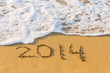 New Year 2014 is coming concept. Inscription 2014 on beach sand.