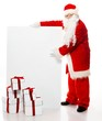 Santa Claus with many gift boxes and blank notice board