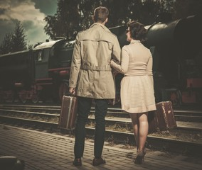Beautiful vintage style couple with suitcases