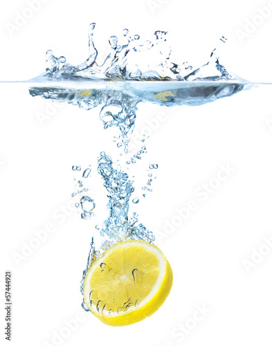 Juicy lemons under water