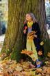 Autumn fun - lovely fashion girl in autumn park