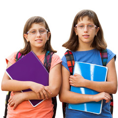 Two handicapped students with notebooks.