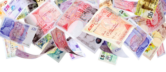 Panoramic image of falling Pound banknotes isolated on white