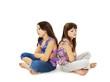 Two little girls back to back in quarrel