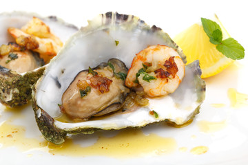 close up of fried oysters and shrimps in a shell isolated on whi