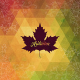 Vector autumnal maple leaf background made of triangles. Retro b