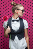 Portrait of trendy girl with ponytail hairstyle and pink flower poster