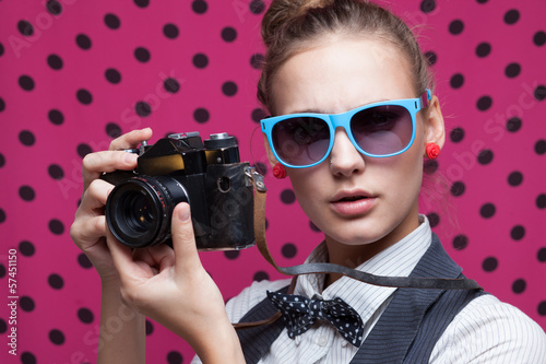 Closeup of trendy girl face in colorful sunglasses