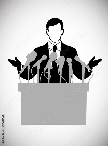 silhouette of the person addressing public at a microphone