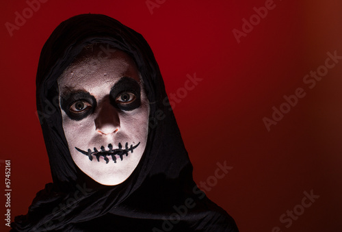 scary skull woman red background