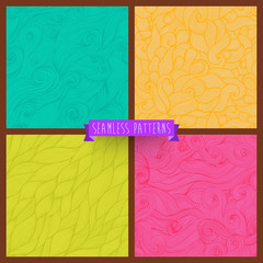 Vector set of four seamless hand-drawn pattern, waves background