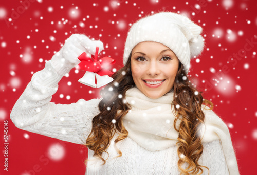 smiling woman in mittens and hat with jingle bells