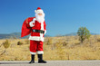 Full length portrait of a Santa claus with bag full of presents