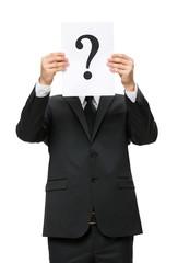 Half-length portrait of businessman handing question mark