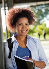 Female Student Smiling On University Campus