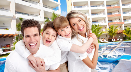 Happy family in tropical ressort.